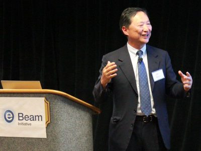 Aki Fujimura, CEO of D2S, moderating a panel at an eBeam event